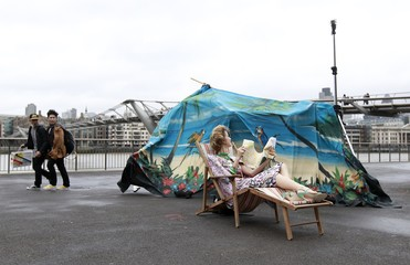 A  photo background falls down during a windy day in central London