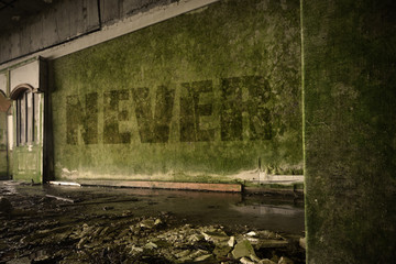 text never on the dirty wall in an abandoned ruined house