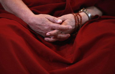 Tibetan spiritual leader the Dalai Lama gathers his hands while he speaks at a news conference in Yokohama