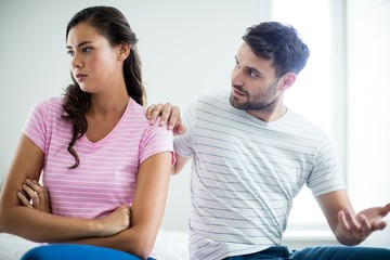 Couple arguing with each other in bedroom
