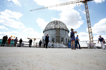 People visit the building site of the Berliner Schloss (Berlin City Palace) in Berlin, which is undergoing reconstruction