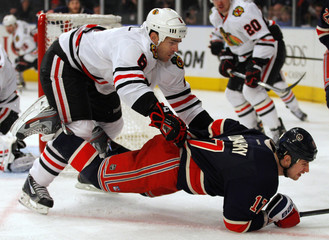 Blackhawks O'Donnell knocks Rangers Dubinsky to the ice during their NHL hockey game at Madison Square Garden in New York