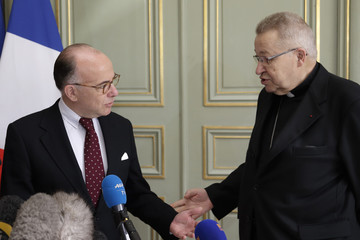 French Interior Minister Cazeneuve and Archbishop of Paris Cardinal Andre Vingt-Trois speak to journalists at the end of a meeting at the Interior Ministry in Paris