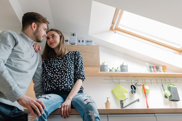 Beautiful couple in love with their new kitchen