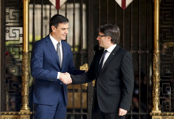 Catalunya's President Carles Puigdemont shakes hands with Spain's Socialist Party leader Pedro Sanchez at Palau de la Generalitat in Barcelona