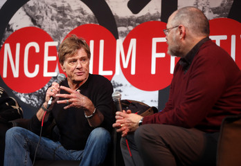 Actor Redford talks with moderator Means as he addresses the media at an opening day news conference for the Sundance Film Festival at the Egyptian Theatre in Park City