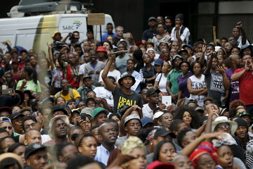 Student gestures during their protest over planned increases in tuition fees outside the headquarters of South Africa's ruling African National Congress (ANC) in Johannesburg