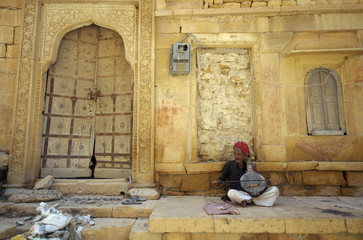 A musician plays a traditional instrument to entertain tourists inside the Jaisalmer fort at Jaisalmer in the desert Indian state of Rajasthan