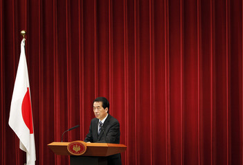 Japan's Prime Minister Naoto Kan holds a news conference in Tokyo