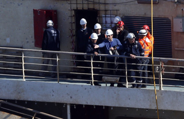 Captain Francesco Schettino gestures as he stands on the Costa Concordia cruise liner at the Giglio harbour