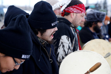 Opponents of the Dakota Access oil pipeline rally outside the Bank of North Dakota in Bismarck