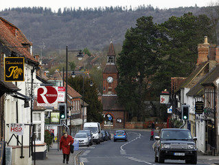 A woman walks past a HS2 protest sign in Wendover