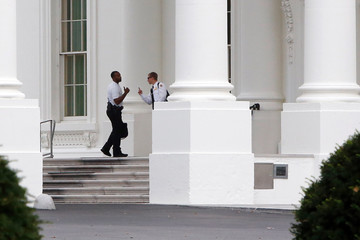 Members of the Uniformed Division of the Secret Service patrol the North Portico of the White House in Washington