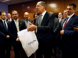 Vodka is delivered to reporters awaiting John Kerry and Russian Foreign Minister Sergei Lavrov to hold a press conference in Geneva