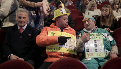 """Men dressed in costumes attend the draw of Spain's Christmas Lottery """"El Gordo"""" in Madrid"""