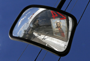 The cabin of a truck of a Russian convoy carrying humanitarian aid for Ukraine is reflected in a side-view mirror near a Russia-Ukraine border crossing point in Rostov Region