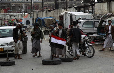 Armed tribesmen loyal to tribal leader Sadiq al-Ahmar man a checkpoint on a street leading to his house in Sanaa