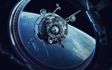 Widok z iluminatora statków kosmicznych. Ziemia i statek kosmiczny. Elementy tego obrazu dostarczone przez NASA