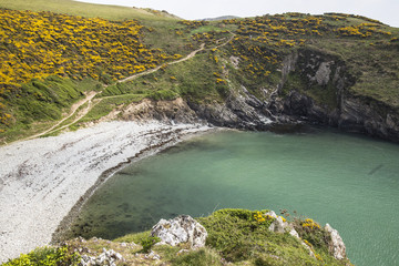 Small beach and coastal path from the end of the Southern headland at Solva, Pembrokeshire, South Wales, UK.