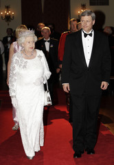 Britain's Queen Elizabeth walks with Canada's Prime Minister Stephen Harper before a state dinner in Toronto