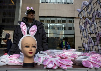 A man sells bunny ears at the Easter Parade and Bonnet Festival along 5th Avenue in New York City