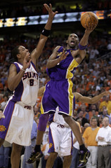 Los Angeles Lakers guard Kobe Bryant scores against Phoenix Suns center Channing Frye in the fourth quarter during Game 4 of the NBA Western Conference finals in Phoenix