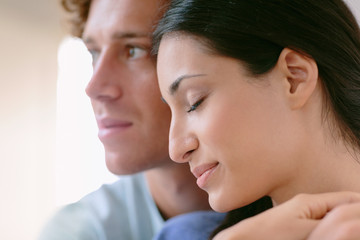 Portrait of young couple happy and daydreaming