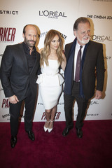 """Cast members Statham and Lopez pose with director Hackford as they arrive for premiere of the film """"Parker"""" in New York"""