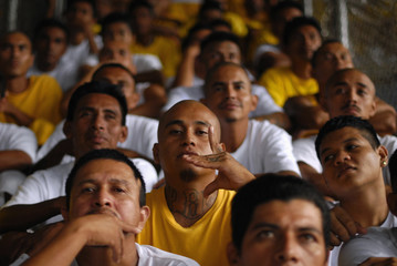 A gang member flashes his gang's sign during a mass at the prison of Izalco, about 65 km (40 miles) from San Salvador