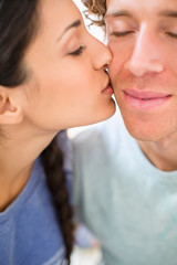 Close-up of woman kissing boyfriend on chick