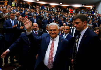 Turkey's new Prime Minister Yildrim greets members of parliament from his ruling AK Party (AKP) as he arrives for a meeting at the Turkish parliament in Ankara