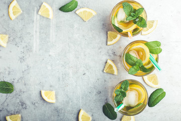 Homemade iced lemon sweet tea with mint, top view