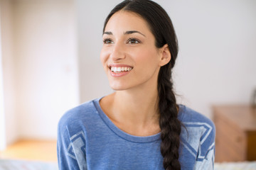 Portrait of beautiful young woman smiling happy