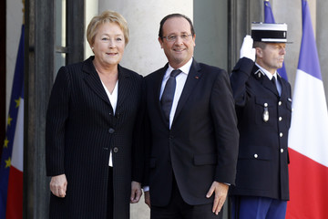 France's President Francois Hollande welcomes Quebec's Premier Pauline Marois as she arrives for a meeting at the Elysee Palace in Paris