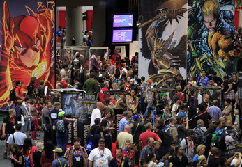 Comic Con attendees fill the convention hall during the pop culture convention's first day in San Diego