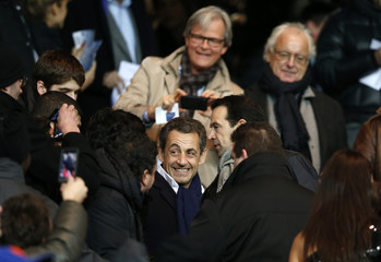 Former French President Sarkozy arrives at the Parc des Princes Stadium to attend the French Ligue 1 soccer match between Paris Saint-Germain and Olympique Lyon in Paris