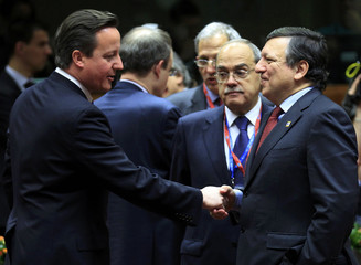 Britain's PM Cameron talks with European Commission President Barroso at a European Union summit in Brussels