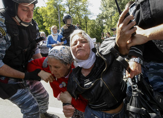 Riot police try to stop Orthodox Christian activists as they protest against the march of gay rights activists across Kiev