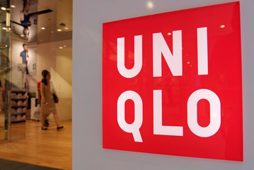 Shoppers walk inside Fast Retailing's Uniqlo casual clothing store in Tokyo