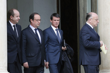 From L-R, French Justice Minister Urvoas, French President Francois Hollande, Prime Minister Valls and Interior Minister Cazeneuve walk together following a crisis meeting at the Elysee Palace in Paris