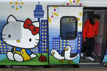 A man walks out from a Hello Kitty-themed Taroko Express train in Taipei, Taiwan