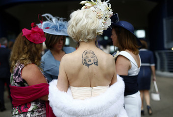 A racegoer displays a tattoo of actress Marilyn Monroe during Ladies' Day at the Royal Ascot horse racing festival at Ascot