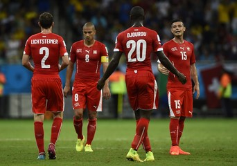 Switzerland's Lichtsteiner,Inler,Djourou and Dzemaili react during their 2014 World Cup Group E soccer match against France at the Fonte Nova arena in Salvador