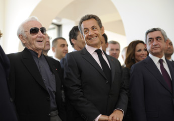 French singer Charles Aznavour, France's President Sarkozy talk in front of the Ararat mount during the visit of the Charles Aznavour house in Yerevan