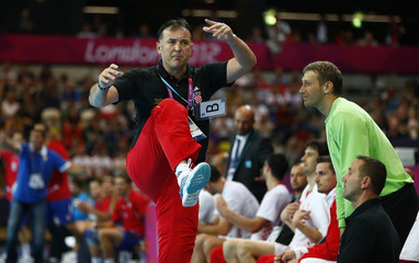 Croatia's Slavko Goluza reacts in the sideline in their men's handball Preliminaries Group B match against Serbia at the Copper Box venue during the London 2012 Olympic Games
