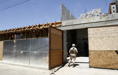 Soldier stands at the entrance of a house, where a cross border tunnel was located, in Tijuana