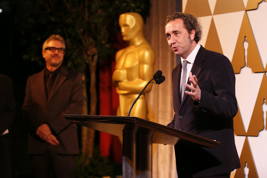 Director Sorrentino accepts his nomination certificate from presenter director Cuaron at the 86th Academy Awards Foreign Language Nominee Reception at Ray's and Stark Bar on the LACMA Campus in Los Angeles,