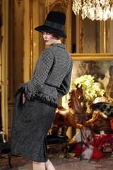 A model presents a creation by British designer John Galliano during Paris Fashion Week