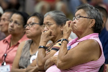 Roberts listens as U.S. Democratic presidential candidate Senator Sanders talks to tribal members during a campaign event at the Meskwaki Nation Settlement near Tama, Iowa