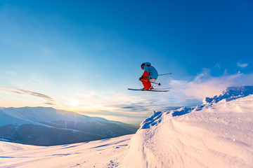 Wall Mural - Good skiing in the snowy mountains, Carpathians, Ukraine. Beautiful winter sunset, incredible ski jump.